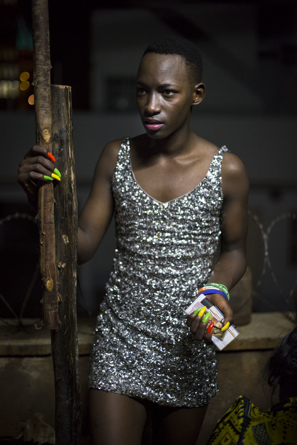 A contestant prepares backstage for the Mister and Miss Pride competition. Kampala, Uganda. August 7, 2015.