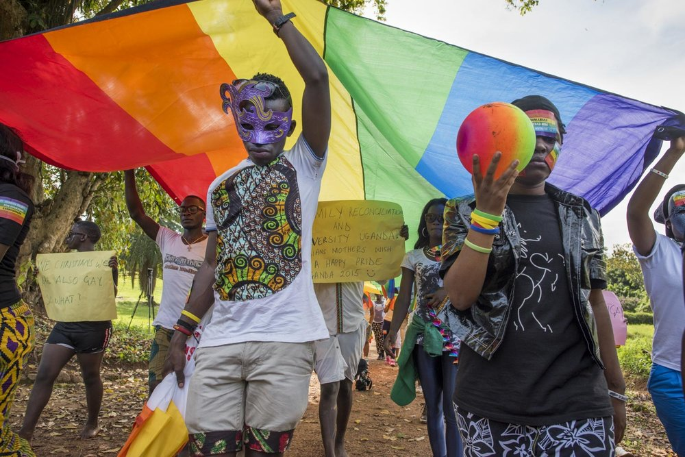 Members of the LGBT community and their supporters participate in a Pride march in a park on the banks of Lake Victoria in Entebbe, 40 km from Kampala. Safety concerns made it impossible to hod the march in a more public location like downtown Kampala. Entebbe, Uganda. August 8, 2015.