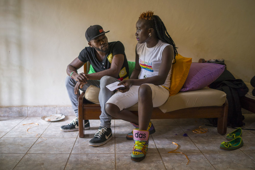 Two members of the LGBT community discuss as they prepare for the festivities to be held later that evening. Kampala, Uganda. August 6, 2015.