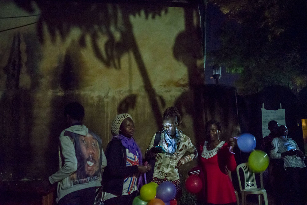 Members of the LGBT community and their supporters prepare to leave the coutryard that hosted the evening's events. Kampala, Uganda. August 6, 2015.