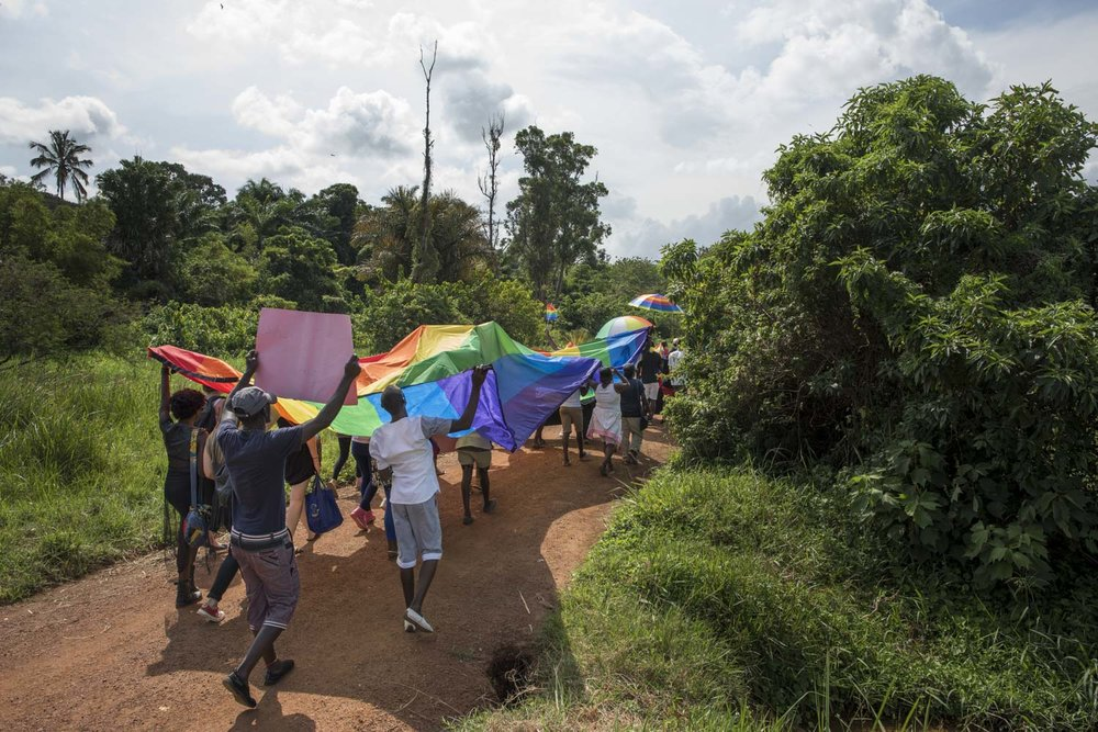 Members of the LGBT community and their supporters participate in a Pride march in a park on the banks of Lake Victoria in Entebbe, 40 km from Kampala. Safety concerns made it impossible to hold the march in a public location like downtown Kampala. Entebbe, Uganda. August 8, 2015.