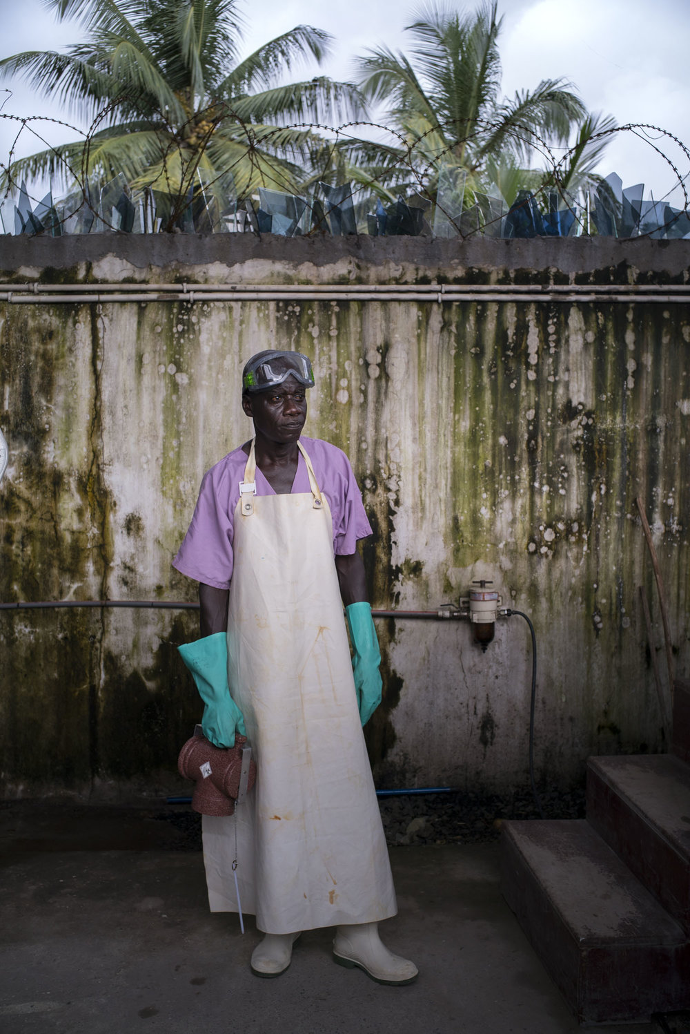 Alfred Walker, 52, Water and Sanitation Supervisor of an MSF hospital in Monrovia, Liberia, stands by the stairs leading to the incinerator, which is used for safe disposal of medical waste. In the aftermath of the the ebola epidemic of 2014/15 that left an estimated 4800 dead in Liberia, the hospital adheres to especially strict routine sanitation measures. Monrovia, Liberia. Sept. 28, 2016