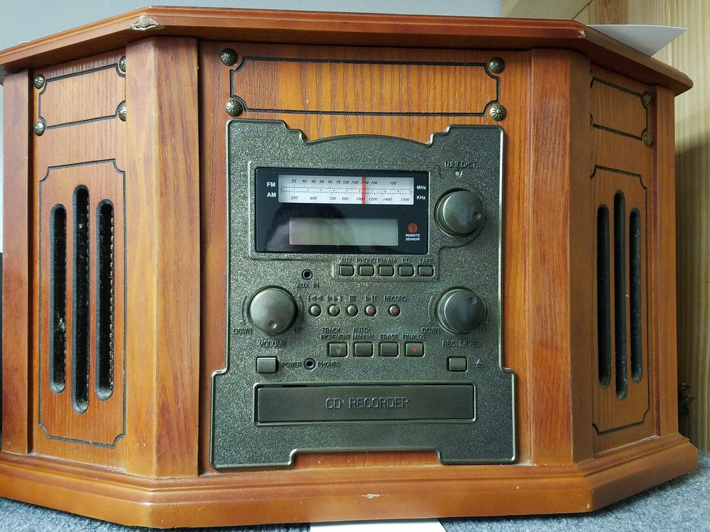 Victoria Integrated Stereo - ITC-TWCDRW - 285.00  Used  SPECIFICATIONS    - Intellitouch Victoria Tunewriter phonograph - Records directly from the built-in turntable, cassette player, or from an auxiliary input onto CD-R/RW discs - Two full-range speakers deliver stereo - LCD Display with blue backlight - Headphone jack - Full function remote control - Function selector - Paprika wood-style cabinet with beautiful nostalgic details - Similar to the Crosley SONGWRITER - CD RECORDER: - Front-loading drawer type CD recorder/player - Supports CD-R/RW record and play - Records phono to CD, cassette to CD, auxiliary input to CD - CD-DA, CD-R, CD-RW disc compatible - Record level control and record level indicator - Up to 32-track CD music memory - TURNTABLE: - 3-Speed belt-drive turntable (78, 33, and 45 RPM) - Built-in adapter for 45 RPM records - Automatic tone arm return at end of play - AMPLIFIER/TUNER: - Rotary analog AM/FM radio tuner - Rotary volume control - CASSETTE PLAYER: - Side slot cassette with single play function