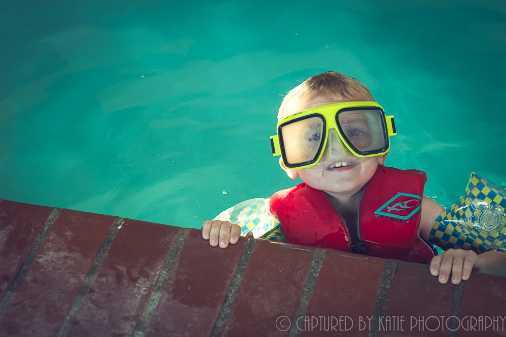Erich is Swimming With The Fishes By Captured By Katie Photography, Bonney Lake Photographer