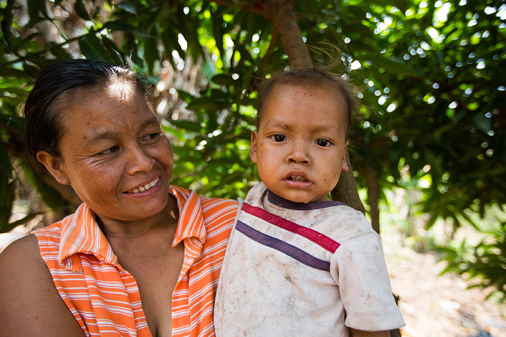 A pastor's wife pictured with her youngest child. (Gracias a Dios, Honduras)