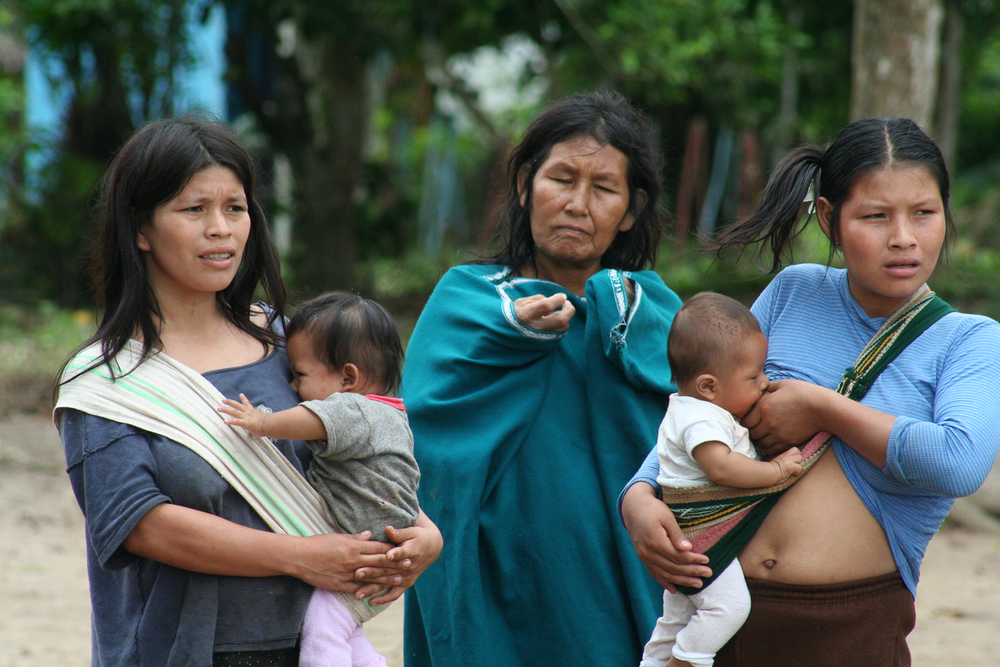 These women in a remote village in the highland jungle of Peru take care of their babies while watching the medical team who came to treat patients.