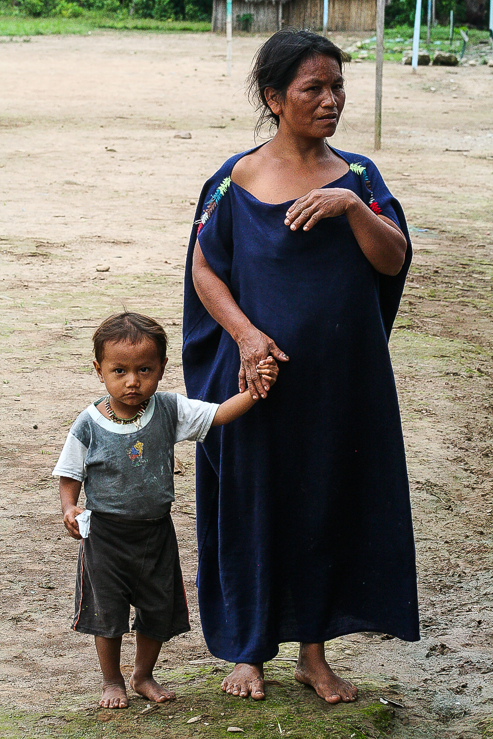 A mother and her child stand watch at a medical clinic in the Peruvian high jungle.