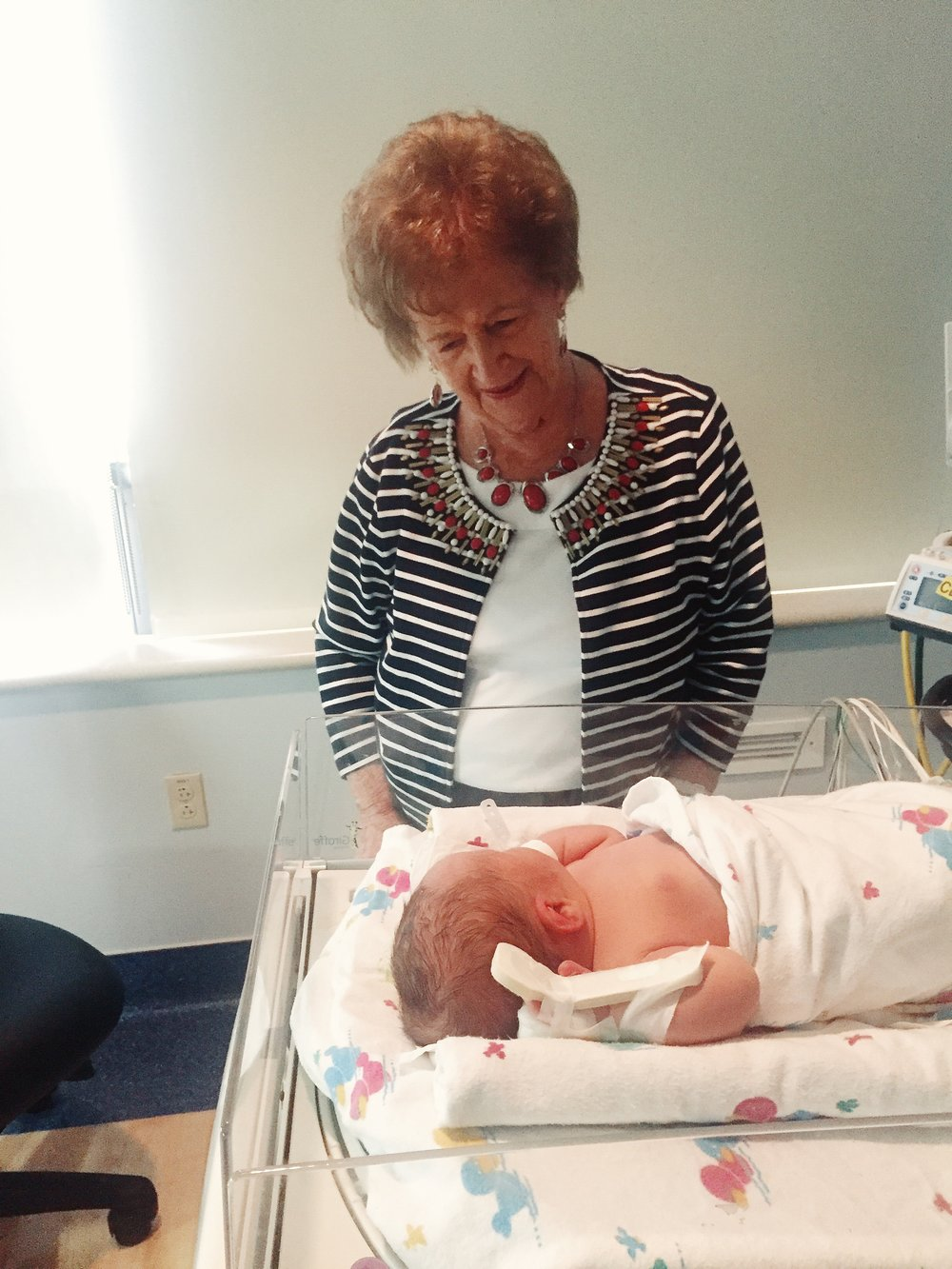 My grandma meeting Ezra, her first great-grandbaby