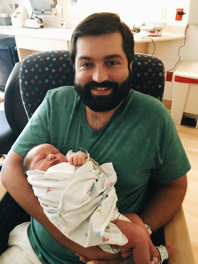 Reed finally getting to hold Ezra.