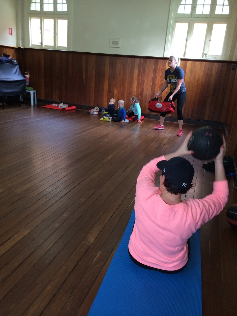 Children don't miss a beat, they watch while mum exercises, they join in and they learn from example.