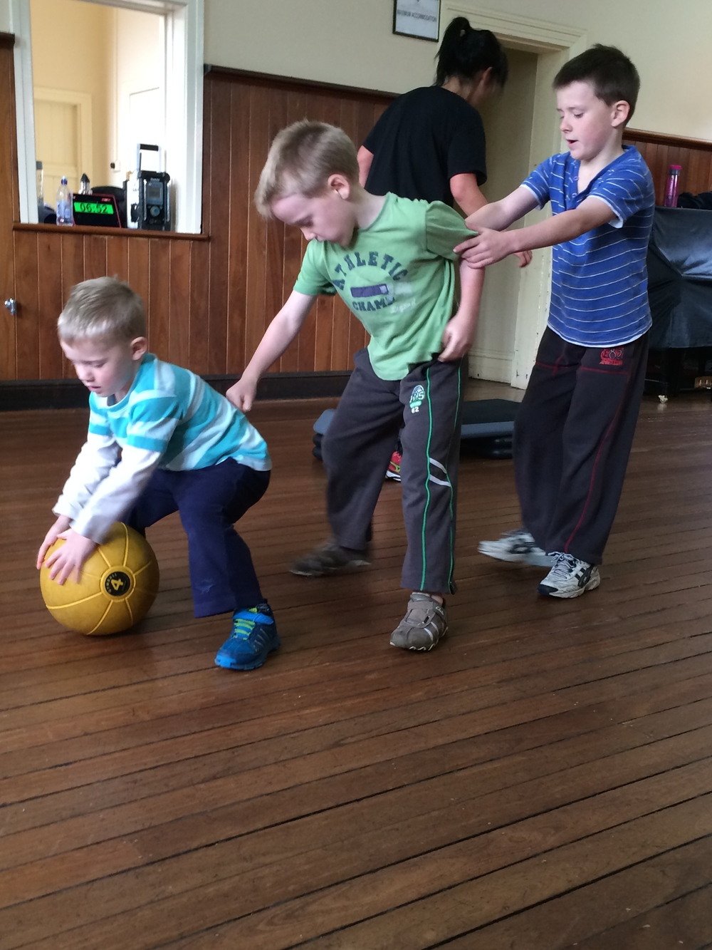 The little dudes play, tunnel ball while mummy exercises.