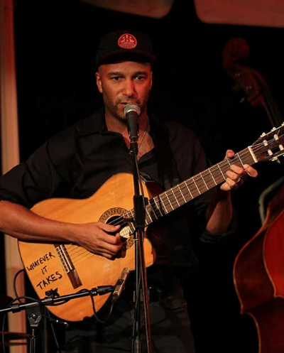 Tom Morello performing at an evening honoring Daw Aung San Suu Kyi, October 2012.
