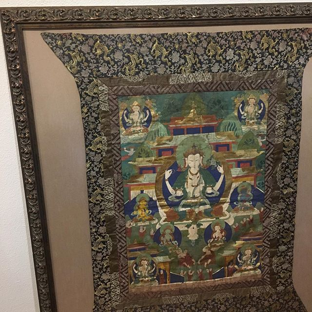 Beautiful old thangka framed with bronze Sofia frame from Larson Juhl and floated on fabric. #thangka #customframing #buddhistart @larsonjuhl
