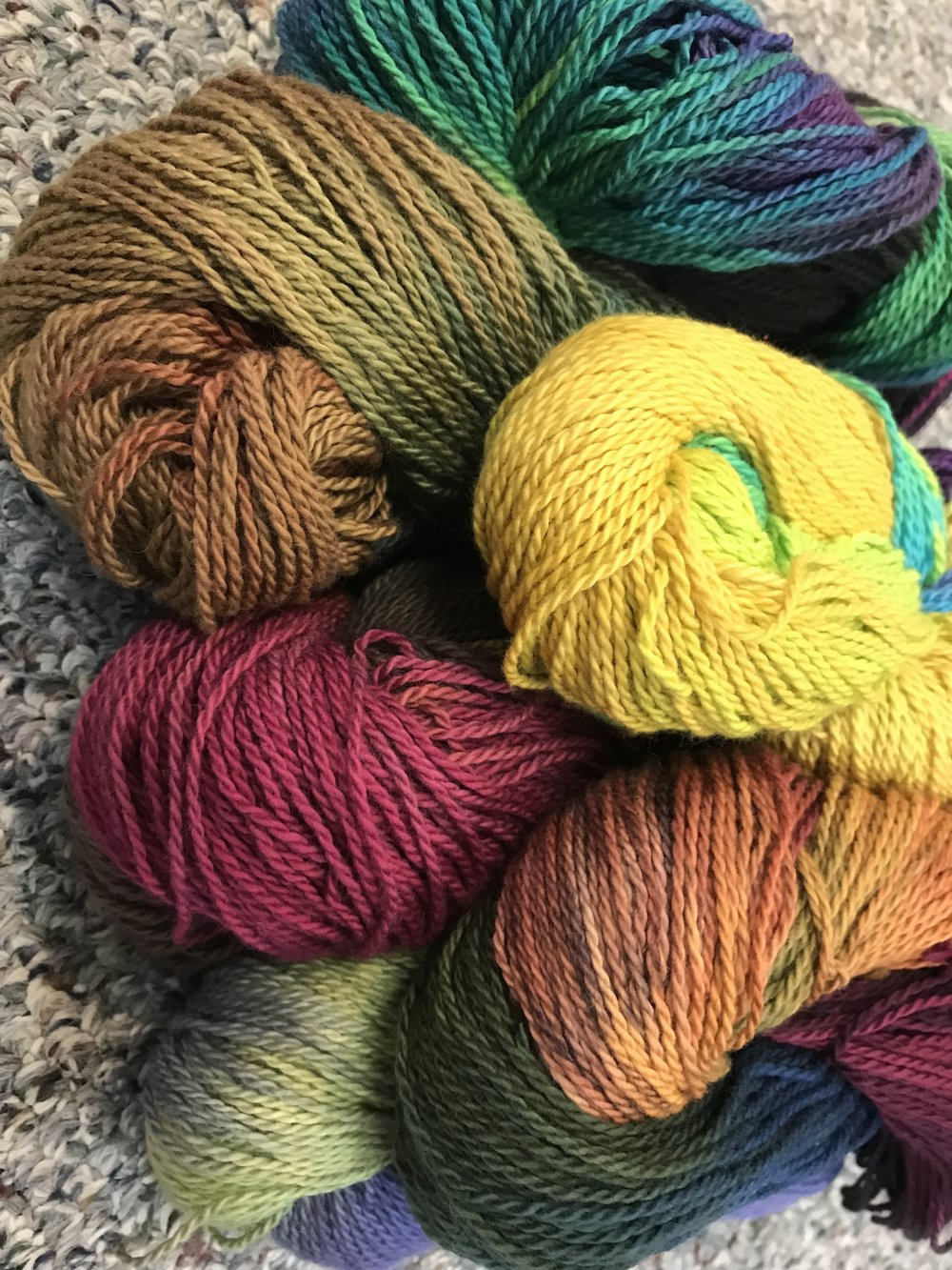 """Adirondack Organic   hand-dyed cotton in dk weight. Many fun colorways for sweaters, scarfs, light """"wristies""""and hats. We love this yarn. Wash in cold water, separately the first time."""