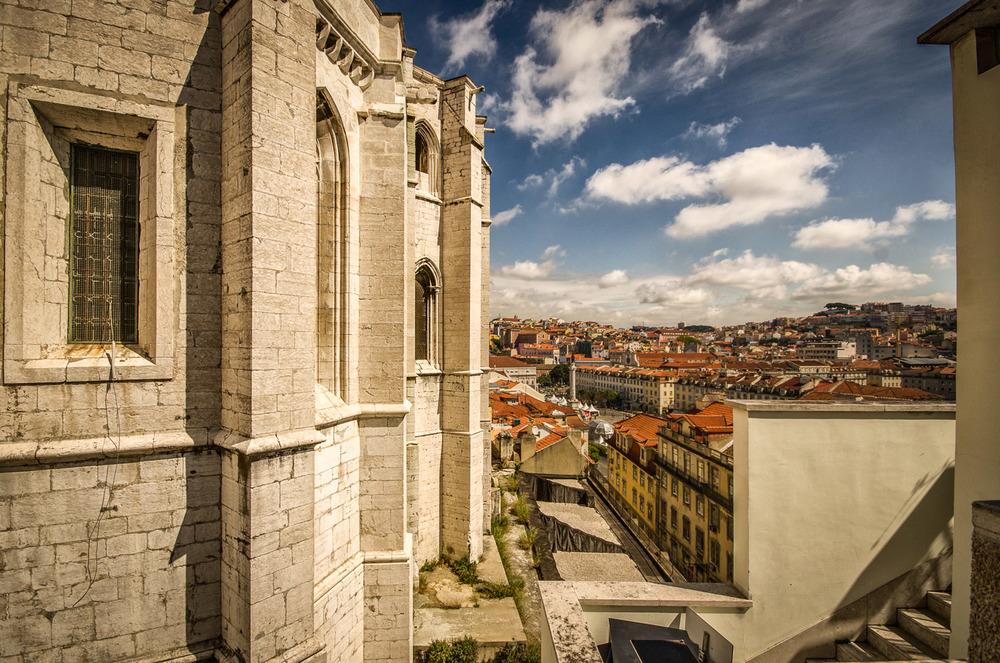 From this Lisbon viewpoint it's possible to see Carmo convent in the foreground and Rossio Square in the background - photo taken from the Santa Justa lift during a Lisbon photo tour.