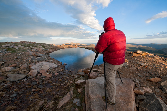 Chris Kayler photographing atop 14,000 ft. tall Mt. Evans during a chilly summer's evening, Colorado.
