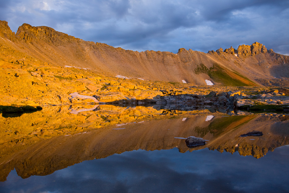 """""""Blue and Gold"""" - A stormy sunrise high in the San Juan mountains. Colorado."""
