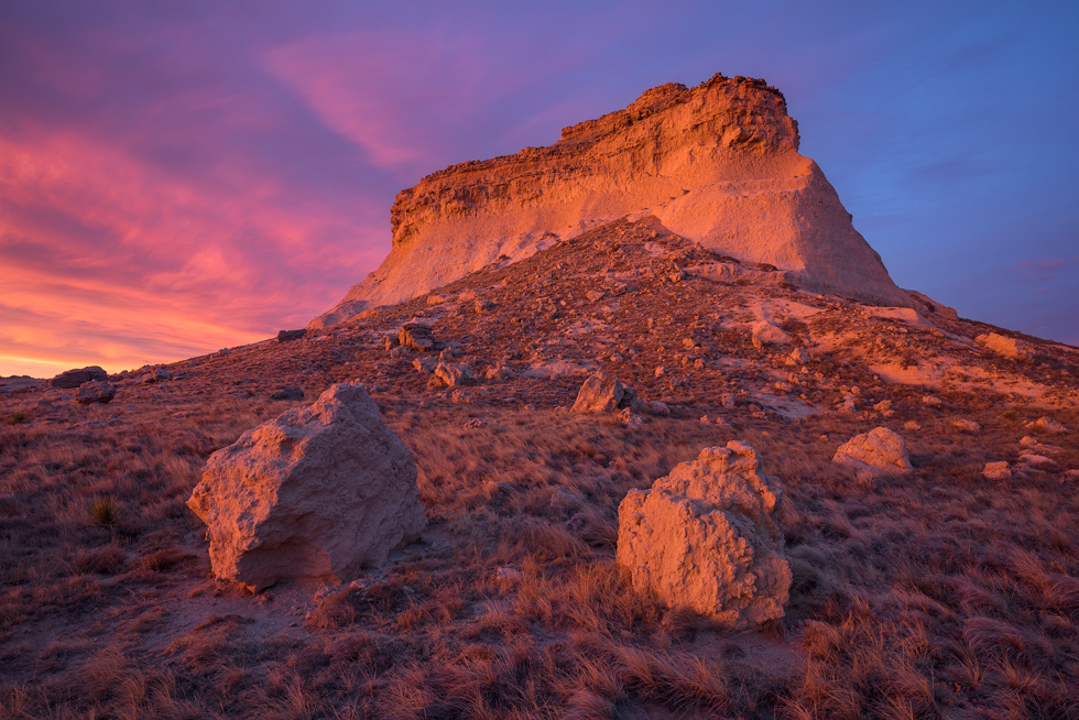 """Duality"" - Warm sunrise light glows on the face of one of the Pawnee buttes. Pawnee National Grassland, Colorado."