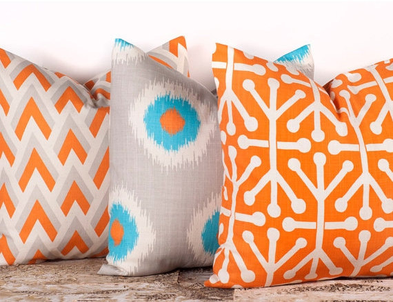Sitting Pretty: Add a pop of color to your couch with these orange patterned pillow covers. On sale at  Etsy .