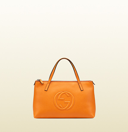 This  Gucci  orange tote makes a bold yet classic statement.
