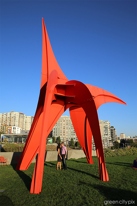 "Under the ""Eagle"" by Alexander Calder. I love how the red angles of this sculpture pierce through the blue sky."