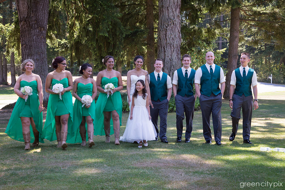 The bridal party, in emerald green and cowboy boots.