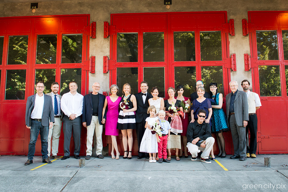 Red hot: These doors created a great backdrop for the gorgeous bridal party. Photo taken by the fire station on Main and Second in Seattle's Pioneer Square.