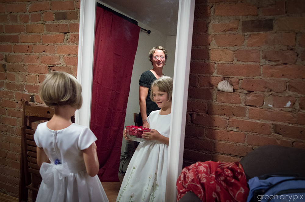 The flower girl gets ready for her walk down the aisle.
