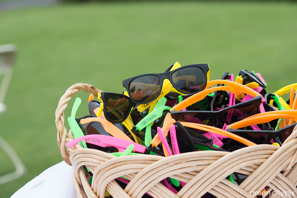 Colorful sunglasses were given to guests for the outdoor ceremony.