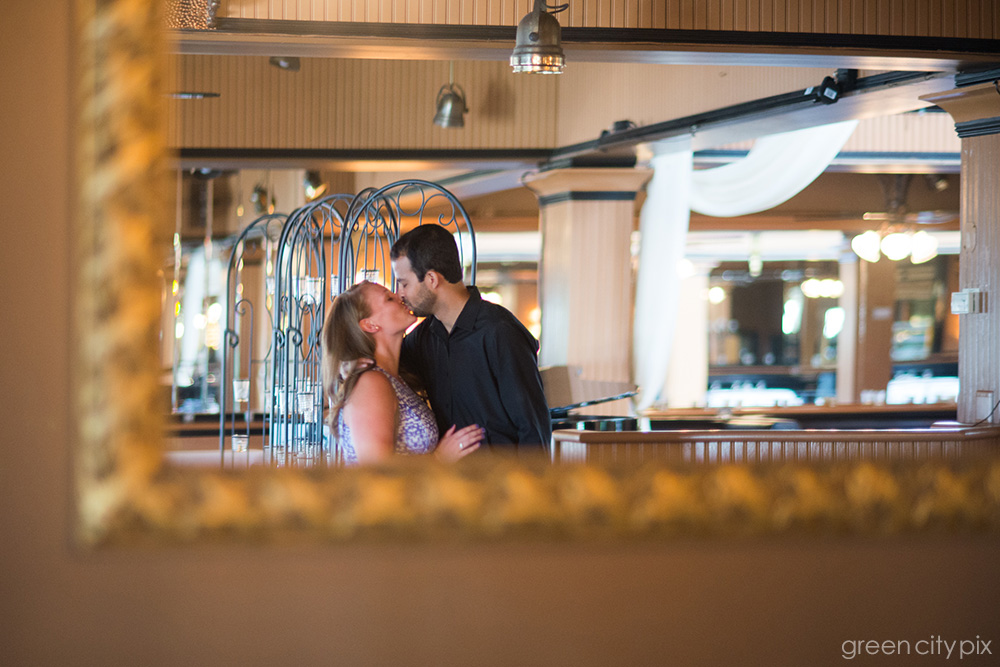 Kiss caught in a mirror. I like how this almost looks like a hotel reception area.  Photo taken at   Lake Union Cafe  .