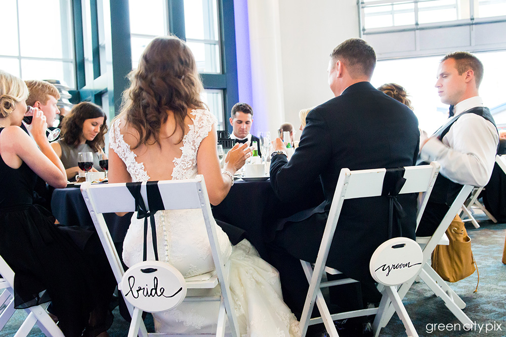 Baby got back: I love the open V-back on Annie's dress, and the cute bride and groom signs on their chairs.
