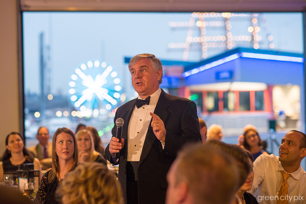 I love how the colored lights in the city's waterfront provided a backdrop for the bride's father as he was giving his speech.