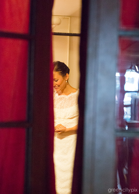 A peek at the bride, through a doorway at the Kitchen by Delicatus.