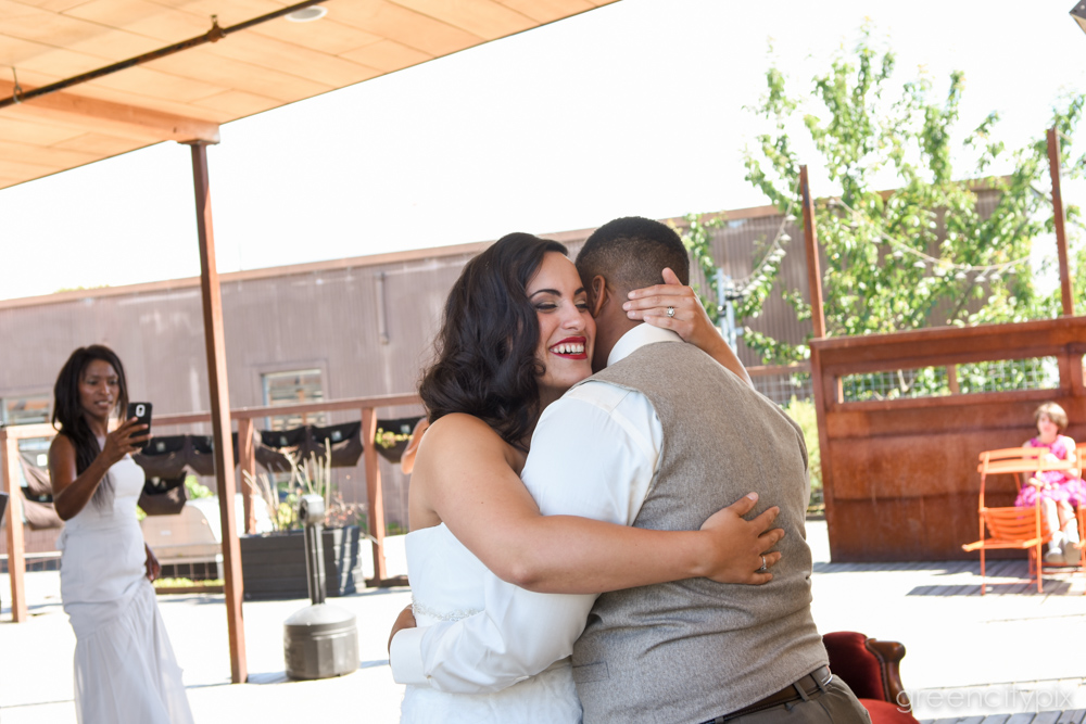 A hug before they jumped the broom and made it all official!