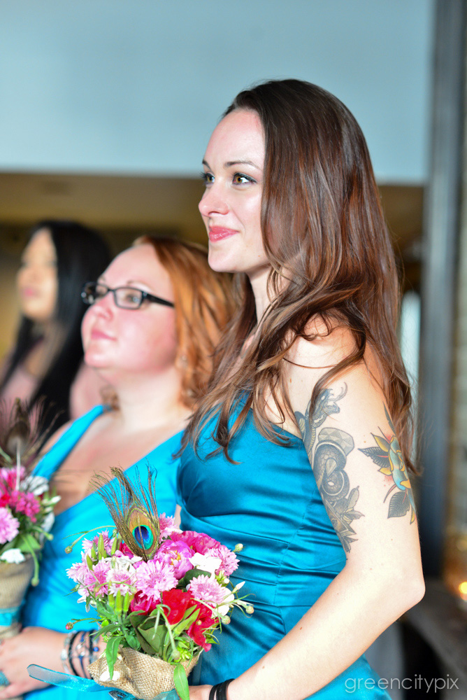Tattooed bridesmaid looking lovely and chic.