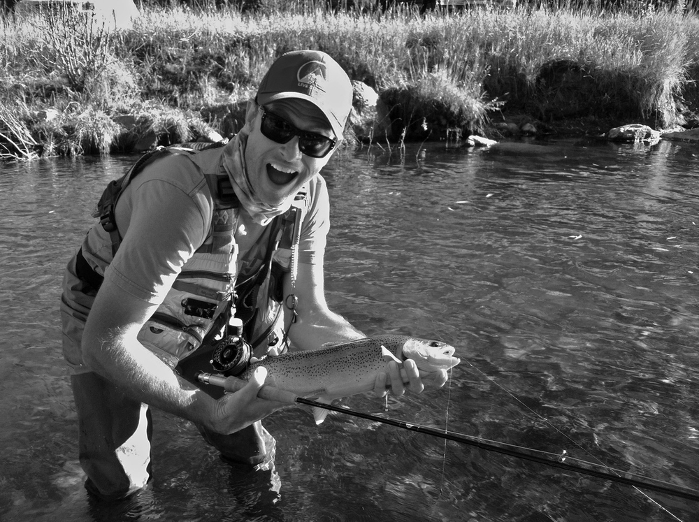 "This is one of my favorite fishing moments.  A wild 21"" Rainbow Trout caught near Evergreen, Colorado on a size 20 Shane Stalcup mayfly nymph that I tied. Yea, my expression says it all... Surprise and awe!"