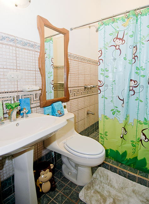 A Monkey Decor In The Bathroom Makes Shower Time Fun. Adults Can Enjoy A  More Sophisticated Palm Tree Bathroom Decor.