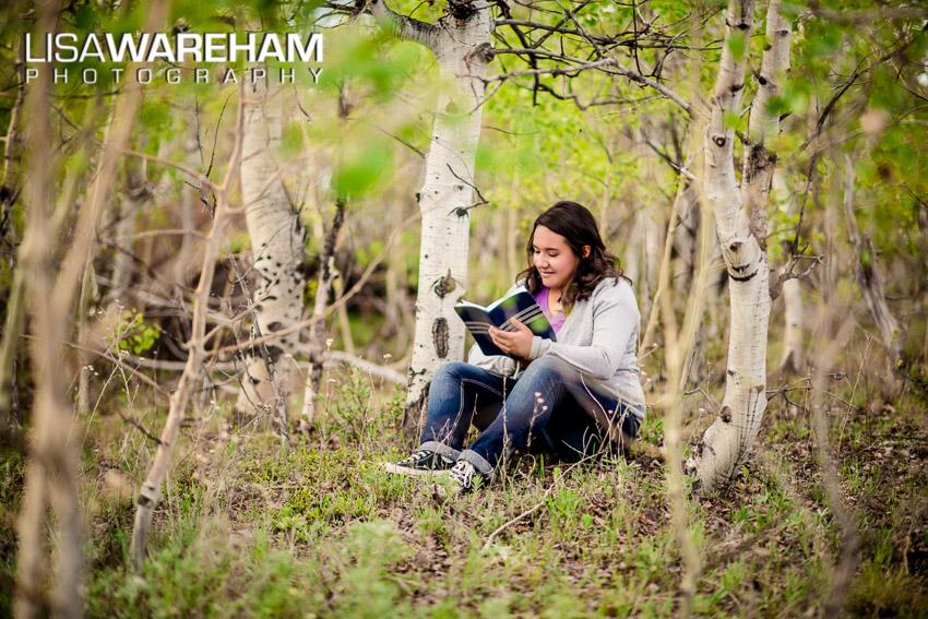 funloving-senior-portrait-in-woods-butte-montana.jpg