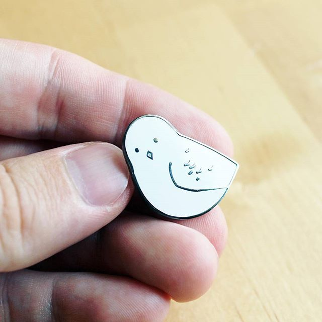 New snowy owl pins for sale on my website! Hard enamel, black nickel plating.  Link is in profile / studiotuesday.com/shop #project100owls @studiotuesdayart