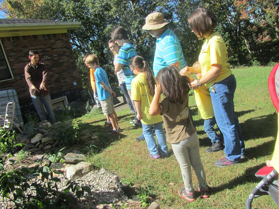 Families tour Wild Earth's gardens
