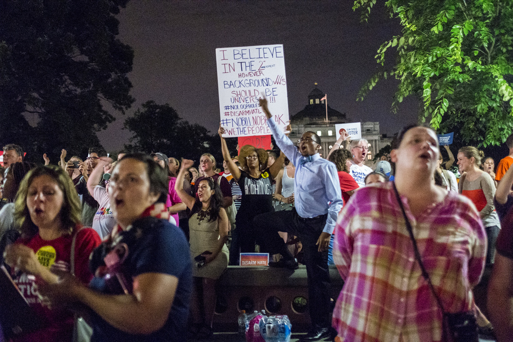 Protesters outside the U.S. Capitol building cheer in support of the Dem Sit In.
