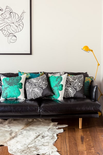 Sarah_Anderson_Photography_Maja_Creative_sofa_cushions_rug_painting_wooden_floorboards