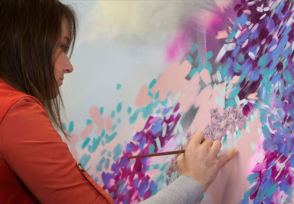 Amy Wright  painting the   'Marine Botanicals'   series in her studio.