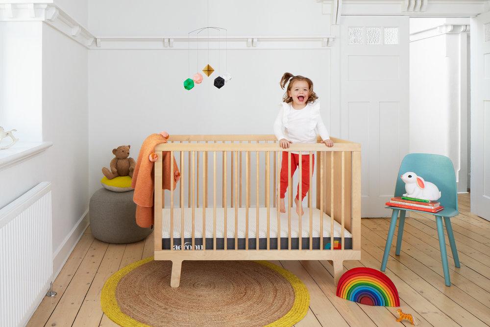 Sarah_anderson_photography_Aerobu_baby_mattress_jumping_in_cot