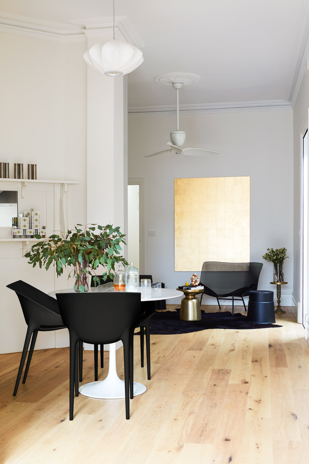 Walls, Dulux paint; colour: natural white.   Royal Oak floors South Yarra; architect collection, American oak aged smoked.   Grillage metal arm chair in black small by Ligne-Roset; designer: Francois Azambourg .  Dining chair: Dr. YES by Kartell; designers: Phillippe Starck with Eugeni Quitllet.
