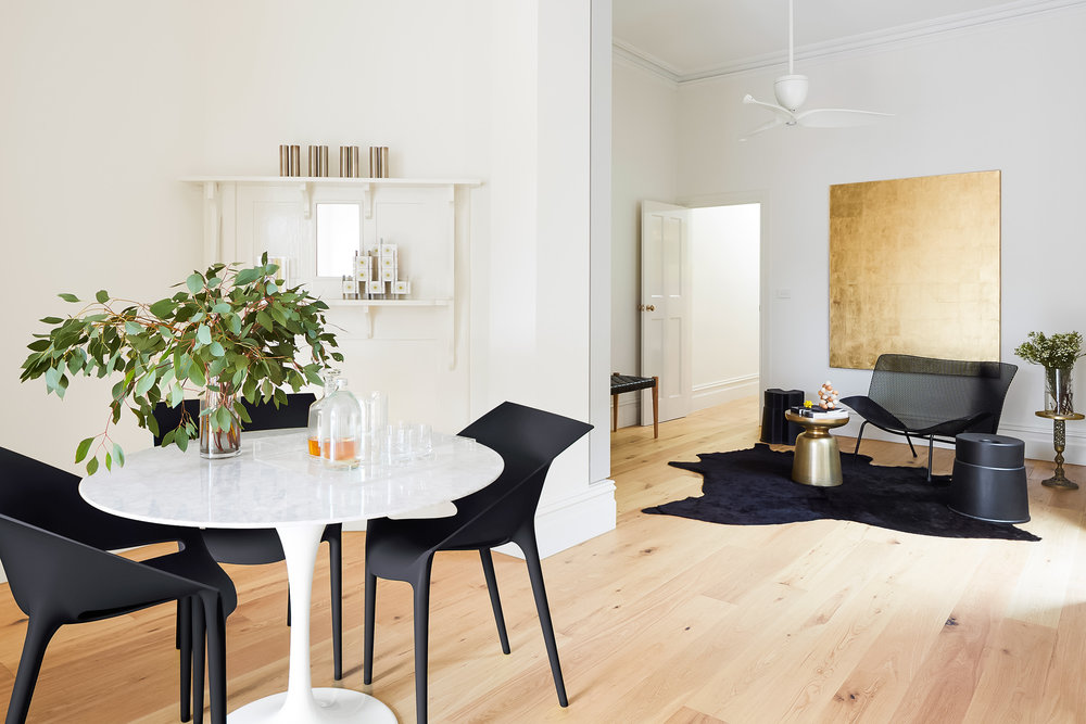 Walls, Dulux paint; colour: natural white.   Royal Oak floors South Yarra; architect collection, American oak aged smoked.   Dining chair: Dr. YES by Kartell; designers: Phillippe Starck with Eugeni Quitllet.   Grillage metal arm chair in black small by Ligne-Roset; designer: Francois Azambourg .