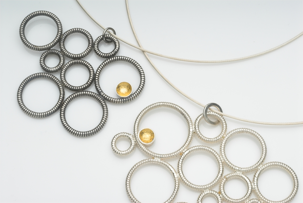 Oxidised silver & gold leaf pendant on silver cable wire £290, silver & gold leaf version £280