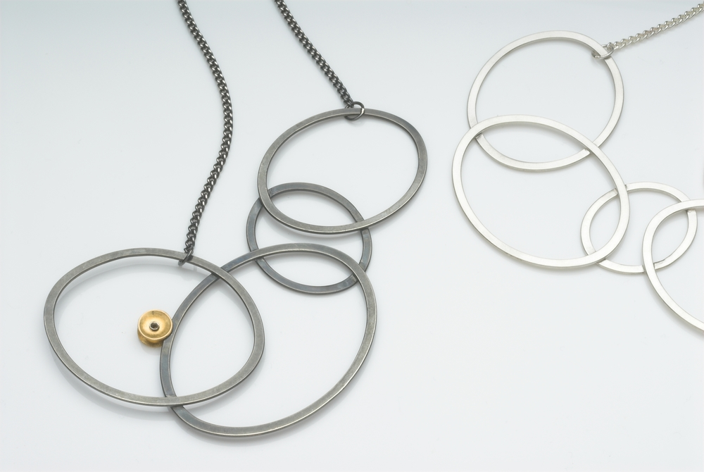 Silver, oxidised silver  and gold plate necklaces  £280-£320