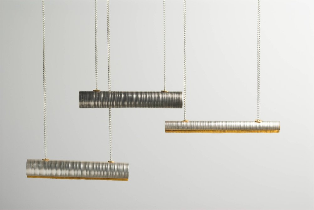 3 Tube necklaces, silver and gold leaf and gold plate £220-£240