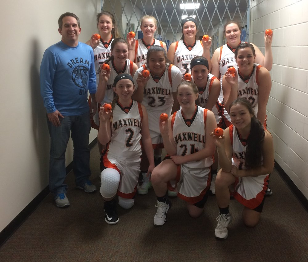 "The Maxwell Tigers girl's basketball team helping us out by throwing out autographed ""Kids & Dreams"" stress basketballs."